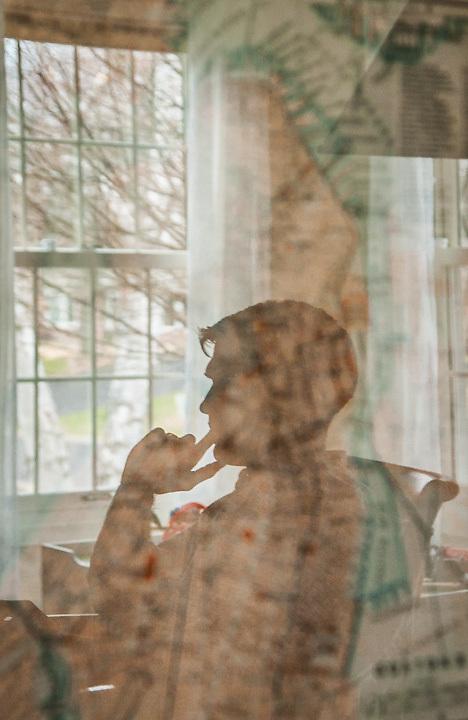 Reflection of Conor Green in his livingroom in Edina, Minnesota