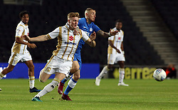 Marcus Maddison of Peterborough United in action with Ryan Watson of Milton Keynes Dons - Mandatory by-line: Joe Dent/JMP - 04/09/2018 - FOOTBALL - Stadium MK - Milton Keynes, England - Milton Keynes Dons v Peterborough United - Checkatrade Trophy