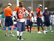 SHOT 7/25/13 9:52:27 AM - Denver Broncos cornerback Champ Bailey #24 watches teammates run through drills during opening day of the team's training camp July 25, 2013 at Dove Valley in Englewood, Co.  (Photo by Marc Piscotty / © 2013)