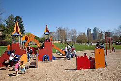 North America, United States, Washington, Bellevue, children playing in playground of Bellevue Downtown Park