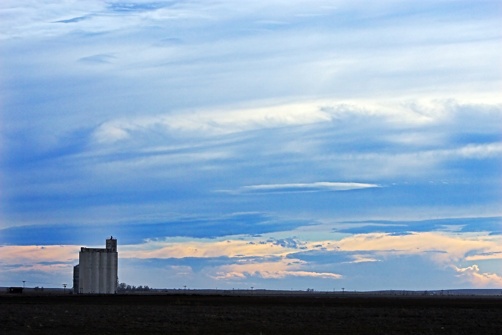 Storms rolling off the Rocky Mountains provide a dramatic backdrop for a small prairie grain elevator in far eastern Colorado.