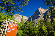 Yosemite Village sign under Yosemite Falls, Yosemite National Park, California USA