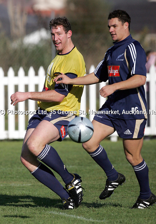 All Blacks Chris Jack and Daniel Carter enjoy a game of soccer  at the All Blacks training session at Waitemata Rugby Club, Henderson on Monday 14 June, 2004. <br />Andrew Cornaga/PHOTOSPORT