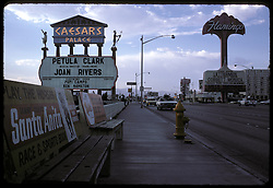 Las Vegas Strip, Caesars Palace and Frontier Casino signs at a bus stop. July 1973. Joan Rivers and Petula Clark playing Caesar's that night and The Letterman and Corbett Monica at The Flamingo.