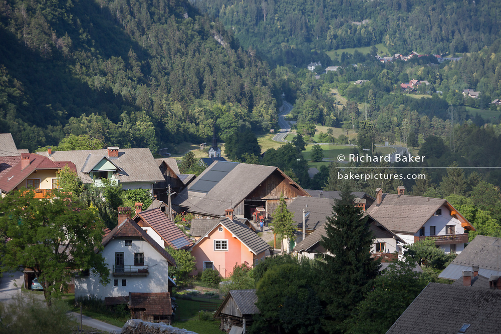 An evening landscape of a rural Slovenian valley village community and nearby hills, on 19th June 2018, in Bohinjska Bela, Bled, Slovenia.