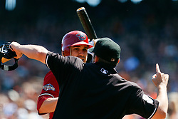 September 4, 2011; San Francisco, CA, USA;  MLB umpire Brian Knight (91) ejects Arizona Diamondbacks right fielder Justin Upton (not pictured) in front of catcher Miguel Montero (back) during the fourth inning against the San Francisco Giants at AT&T Park.