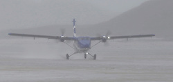 Barra Airport is a short-runway airport situated in the wide shallow bay of Traigh Mhòr at the north tip of the island of Barra in the Outer Hebrides, Scotland. Barra is now the only beach airport anywhere in the world to be used for scheduled airline services. Loganair Twin Otter landing in heavy rain. (c) Stephen Lawson | Edinburgh Elite media