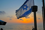 Israeli Flag blue sky at sunset