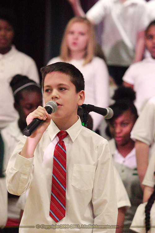 Brandon West leads the Singing Chargers as they perform Masters in the Hall during the 'We Will Jingle!' arts concert at Cleveland PK-8 school in Dayton, Wednesday, December 12, 2012.