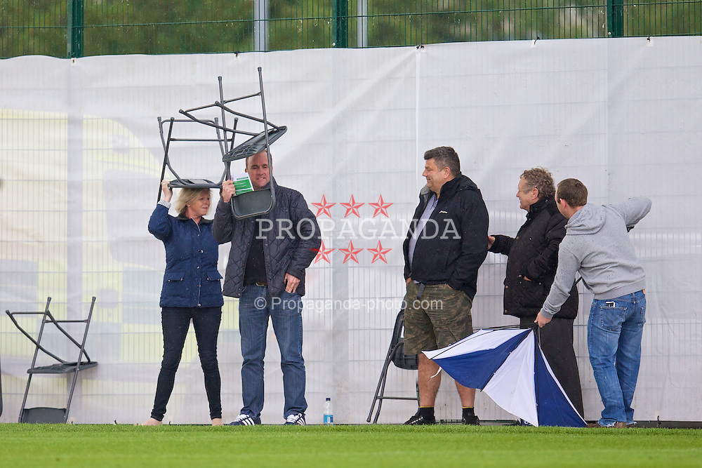 NEWPORT, WALES - Tuesday, May 27, 2014: Parents shelter from the rain during the Welsh Football Trust Cymru Cup 2014 at Dragon Park. (Pic by David Rawcliffe/Propaganda)