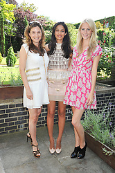 Left to right, BIANCA PITT, SALONI LODHA and POPPY DELEVINGNE at an Indian Tea Party for fashion label Saloni, held at The Coach House, Debenham House, 8 Addison Road, London W14 on 14th July 2009.