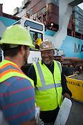 Work begins at the Georgia Ports Authority Garden City Terminal, Saturday, July, 5, 2014, in Savannah, Ga.  (GPA Photo/Stephen B. Morton)