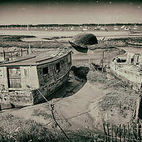 Decaying house boats on the river Deben in Suffolk, England