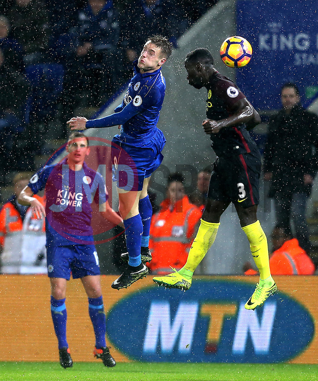 Jamie Vardy of Leicester City beats Bacary Sagna of Manchester City to a header - Mandatory by-line: Robbie Stephenson/JMP - 10/12/2016 - FOOTBALL - King Power Stadium - Leicester, England - Leicester City v Manchester City - Premier League