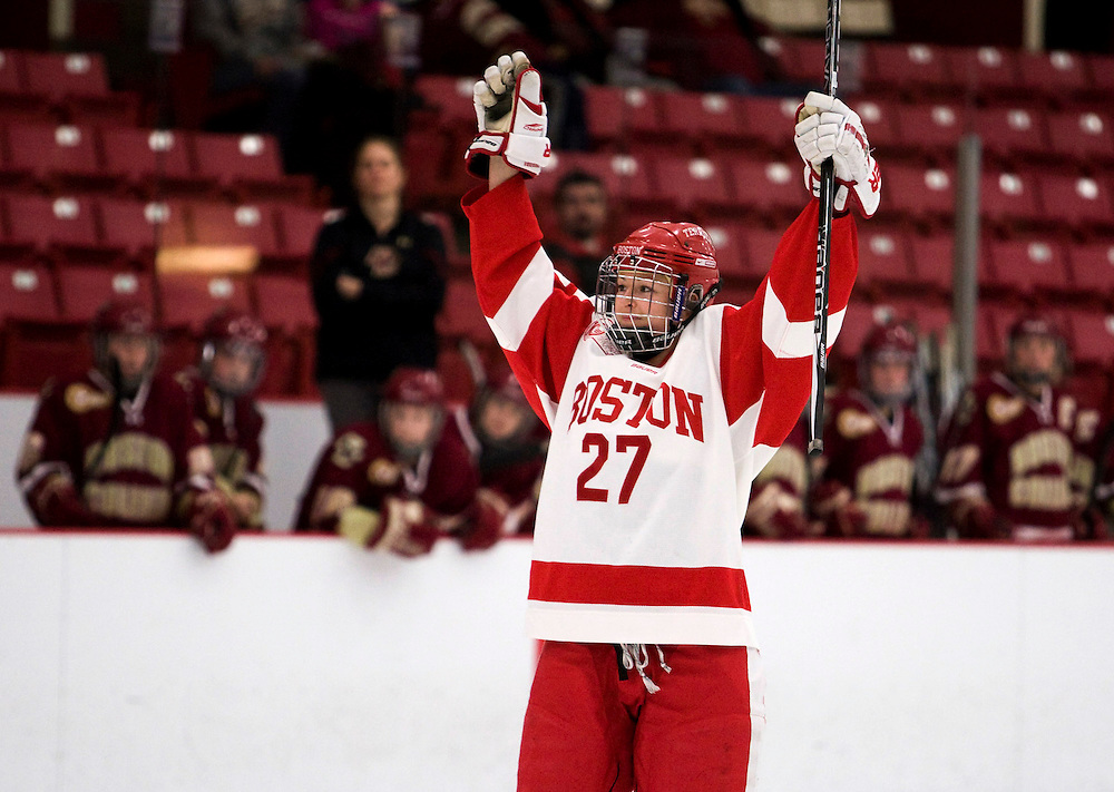 1/25/12 8:37:54 PM -- Boston, Massachusetts..Boston University defense Tara Watchorn celebrates after scoring BU's fourth goal as BU took on BC at the Walter Brown Arena in Boston, Massachusetts on Wednesday, January 25, 2012.  BU won, 6-0, to bring their record with BC to two wins and one loss. ..Photo by Brooks Canaday for Boston University Photography