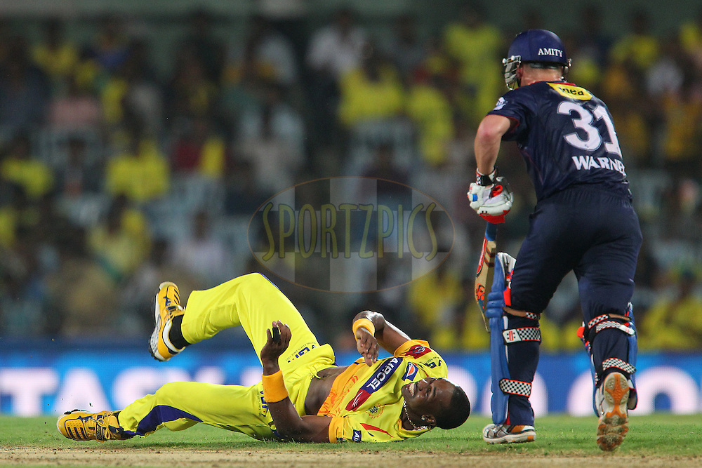 Dwayne Bravo dives to stop the ball from his own bowling during match 64 of the Pepsi Indian Premier League between The Chennai Superkings and the Delhi Daredevils held at the MA Chidambaram Stadium in Chennai on the 14th May 2013..Photo by Ron Gaunt-IPL-SPORTZPICS   .. .Use of this image is subject to the terms and conditions as outlined by the BCCI. These terms can be found by following this link:..http://www.sportzpics.co.za/image/I0000SoRagM2cIEc
