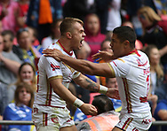 Lewis Tierney (L) of Catalans Dragons  celebrates scoring the 1st try of the game with team mate David Mead (R) against Warrington Wolves during the Ladbrokes Challenge Cup Final match at Wembley Stadium, London<br /> Picture by Stephen Gaunt/Focus Images Ltd +447904 833202<br /> 25/08/2018