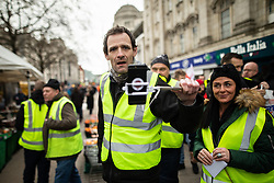 "© Licensed to London News Pictures . 09/02/2019. Manchester , UK . A "" Yellow Vest "" protest in Manchester City Centre , lead by James Goddard . The yellow vest concept has been adopted from French demonstrators by some British groups in support of Brexit , Donald Trump and former EDL leader Stephen Yaxley-Lennon - aka Tommy Robinson . A similar demonstration in the city in January was ridiculed after protesters were kettled by police in front of a branch of Greggs the Baker . Photo credit : Joel Goodman/LNP"