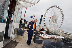 © Licensed to London News Pictures . 22/09/2013 . Brighton , UK . ANDREW MARR waves his walking stick at a temporary broadcast studio on Brighton Pier ahead of his interview with Labour leader , Ed Miliband . Day 1 of the Labour Party 's annual conference in Brighton . Photo credit : Joel Goodman/LNP