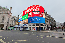 © Licensed to London News Pictures. 25/12/2016. Piccadilly Circus on Christmas Day. Christmas Day morning saw the West End of London's streets almost completely emptied of people. Credit : Rob Powell/LNP