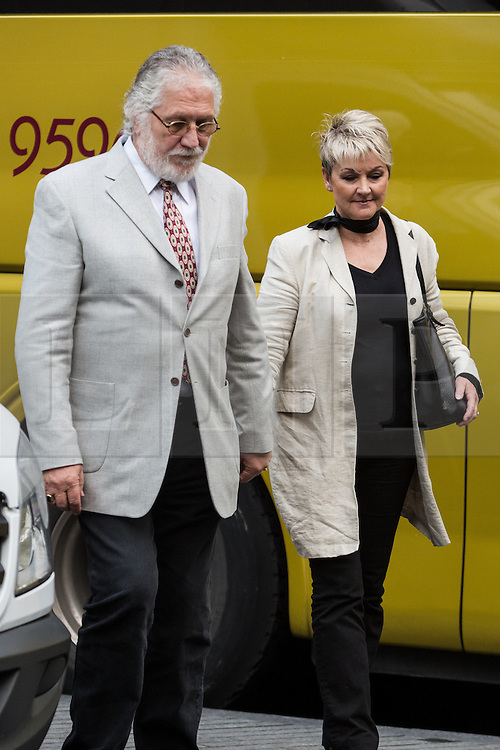 © Licensed to London News Pictures. 19/09/2014. London, UK. Dave Lee Travis, real name David Patrick Griffin with his wife Marianne Griffin, arrive at Southwark Crown Court in London on 19th September 2014. After being cleared of 12 counts of indecent assault in February 2014, Travis has faced a retrial of two charges and a new count of indecent assault. The jury are now deliberating a verdict. Photo credit : Vickie Flores/LNP