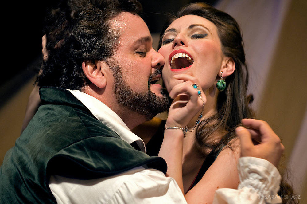 """Rigoletto"" opera at the Dicapo Opera Theatre, conducted by Pacien Mazzagatti; directed by Anthony Laciura. Cast: Zurab Ninua as Rigoletto; Anna Noggle as Gilda; Rafael Davila as Duke of Mantua."
