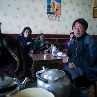 APRIL 3,2012 : Tibetan nomads relax in a restaurant during lunch time.