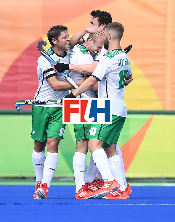 Ireland's Eugene Magee (C) celebrates scoring a goal during the men's field hockey Germany vs Ireland match of the Rio 2016 Olympics Games at the Olympic Hockey Centre in Rio de Janeiro on August, 9 2016. / AFP / MANAN VATSYAYANA        (Photo credit should read MANAN VATSYAYANA/AFP/Getty Images)
