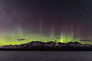 Aurora Borealis over the Chugach Mountains and the Knik River in Southcentral Alaska. Spring. Evening.