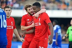 HELSINKI, FINLAND - Friday, July 31, 2015: Liverpool's Divock Origi celebrates scoring the first goal against HJK Helsinki with team-mate Adam Lallana during a friendly match at the Olympic Stadium. (Pic by David Rawcliffe/Propaganda)