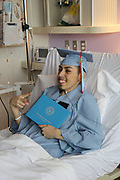 Madison HS senior Erick Reyes receives his high school diploma surrounded by family and friends in a bedside ceremony at Texas Children's Hospital.