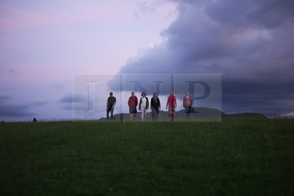 © Licensed to London News Pictures. <br /> 20/06/2014. <br /> <br /> Castlerigg Stone circle, Cumbria, England<br /> <br /> Visitors to the ancient site of Castlerigg Stone Circle near Keswick in Cumbria come to the site to celebrate on the evening of the Summer Solstice.<br /> <br /> Photo credit : Ian Forsyth/LNP