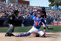 March 18, 2018 - Las Vegas, NV, U.S. - LAS VEGAS, NV - MARCH 18: Victory Caratini (7) of the Cubs makes a pick-off throw down to first base during a game between the Chicago Cubs and Cleveland Indians as part of Big League Weekend on March 18, 2018 at Cashman Field in Las Vegas, Nevada. (Photo by Jeff Speer/Icon Sportswire) (Credit Image: © Jeff Speer/Icon SMI via ZUMA Press)