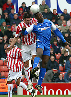 Photo: Dave Linney.<br />Stoke City v Birmingham City. The FA Cup. 19/02/2006.<br />Stoke's (L)beats   Emile Heskey to the ball