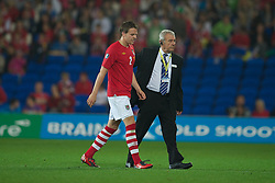 CARDIFF, WALES - Friday, October 8, 2010: Wales' Chris Gunter walks off dejected after being sent off against Bulgaria during the UEFA Euro 2012 Qualifying Group G match at the Cardiff City Stadium. (Pic by David Rawcliffe/Propaganda)