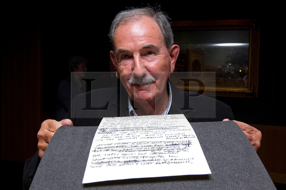 """© Licensed to London News Pictures. 22/05/2013. London, UK. Acclaimed Beatles biographer, Hunter Davies, is seen with the lyrics for the Beatles song 'She Said She Said' (1966) at the British Library in London today (22/05/2013).  The manuscript, along with others and letters between John Lennon and Mr Davies, have been donated to the library under the """"lifetime giving"""" scheme. Photo credit: Matt Cetti-Roberts/LNP"""