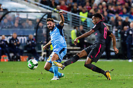 July 13 2017: Arsenal player Joe Willock (69) gets the ball past Sydney FC defender Michael ZULLO (7) at the International soccer match between English Premier League giants Arsenal and A-League premiers Sydney FC at ANZ Stadium in Sydney.
