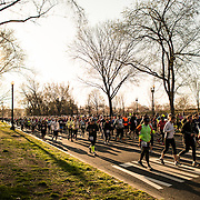 Runners in the 2013 Cherry Blossom 10-Mile Run run along Independence Avenue towards Memorial Bridge. Scheduled to coincide with the National Cherry Blossom Festival in early spring, the race takes runners along the National Mall and by the famous cherry blossoms around the Tidal Basin.