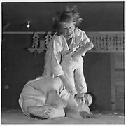 Mrs. Kinoshida, the Russian wife of a center minister of Japanese ancestry, throws a male instructor in a Judo class at the Heart Mountain Relocation Center. -- Photographer: Parker, Tom -- Heart Mountain, Wyoming. 1/7/43<br /> Identifier:<br /> Volume 11<br /> Identifier:<br /> Section B<br /> Identifier:<br /> WRA no. E-614<br /> Collection:<br /> War Relocation Authority Photographs of Japanese-American Evacuation and Resettlement Series 5: Heart Mountain Relocation Center (Heart Mountain, WY)<br /> Contributing Institution:<br /> The Bancroft Library. University of California, Berkeley.