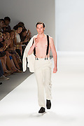 Men's white tuxedo jacket and trousers. By Zang Toi, shown at his Spring 20132 Fashion Week show in New York.