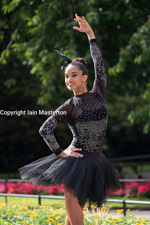 Edinburgh, Scotland, UK; 1 August, 2018. Cuban ballerina Beatriz Torres Cuellar performs in Princes Street Gardens during opening day of the Edinburgh Fringe Festival