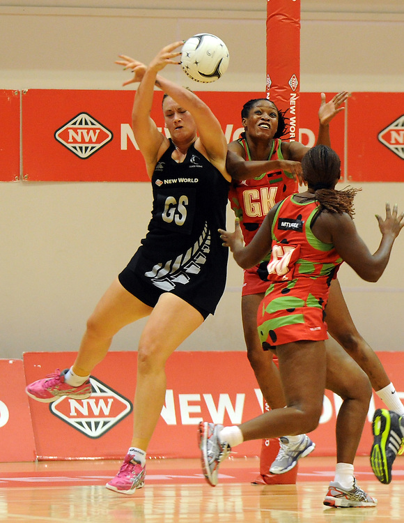 New Zealands' Cathrine Latu, left, contests the ball with Malawis' Towela Vinkhumbo in the International Netball test at Pettigrew Green Arena, Napier, New Zealand, Sunday, October 27, 2013. Credit:SNPA / Ross Setford