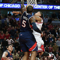 19 December 2009: Chicago Bulls guard Derrick Rose goes for a lay up over Atlanta Hawks' Josh Smith during the Chicago Bulls 101-98 victory in overtime over the Atlanta Hawks at the United Center, in Chicago, Illinois, USA.