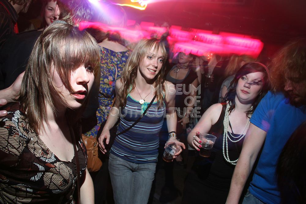 Girls dancing in crowd, Masonic Place, Nottingham.