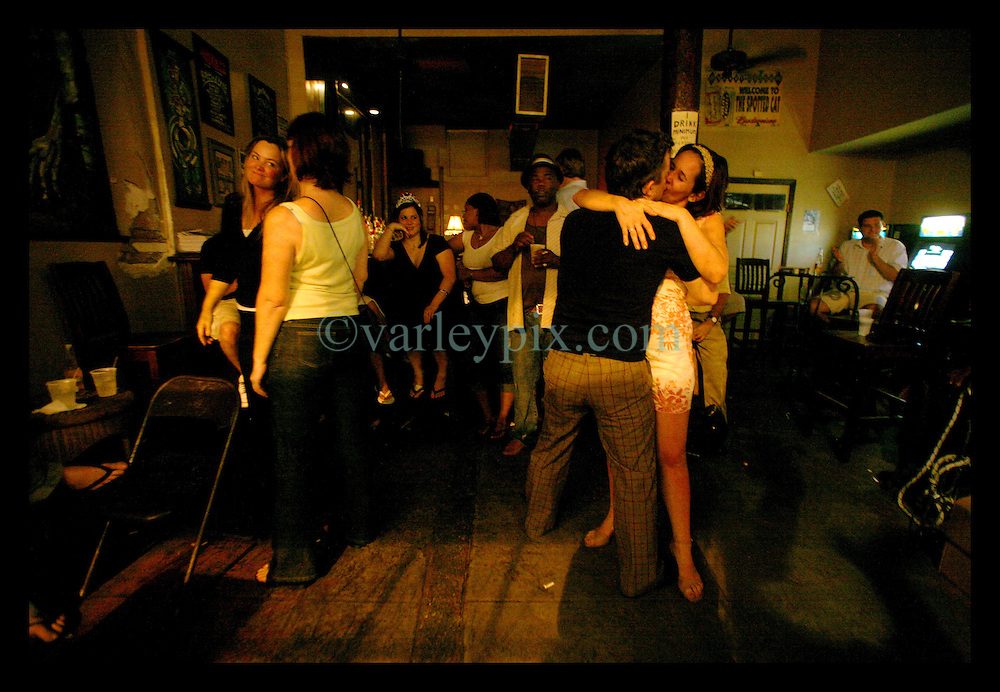 04 August 2006 - New Orleans - Louisiana. Satchmo festival, Frenchman Street, French Quarter. Dancers spin and twirl before ending in a late night kiss at the Spotted Cat bar and club on Frenchman Street.