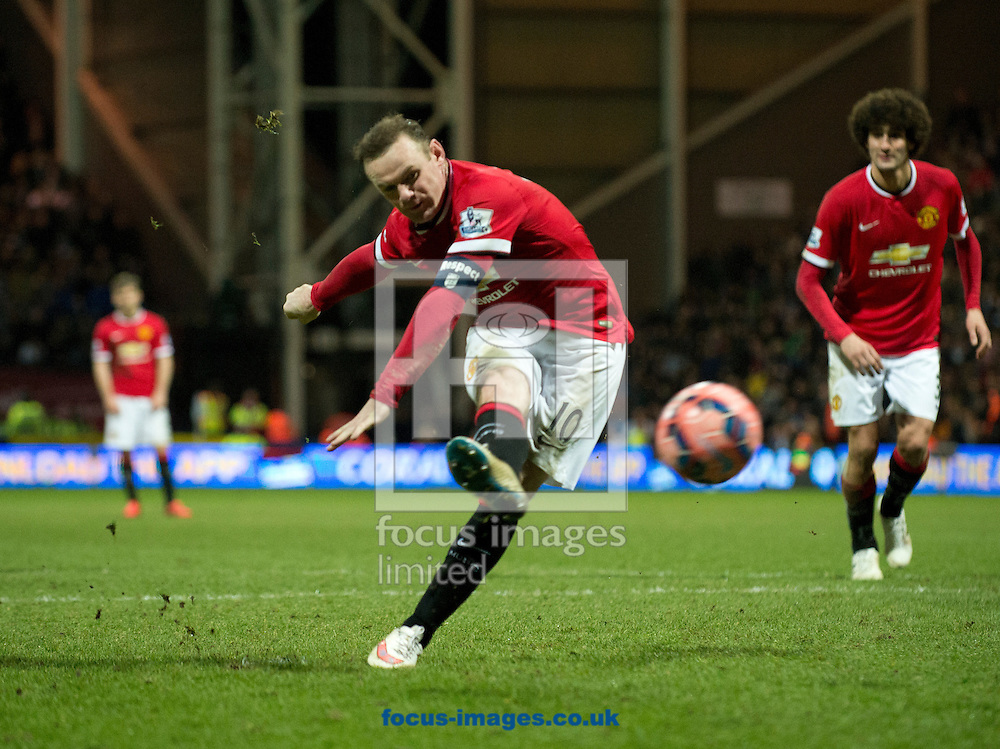 Wayne Rooney of Manchester United scores a penalty to make it 3-1 during the FA Cup match at Deepdale, Preston<br /> Picture by Russell Hart/Focus Images Ltd 07791 688 420<br /> 16/02/2015