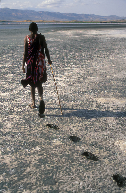 A Masai man walks the dried-out surface of Lake Natron in northern Tanzania.
