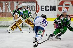 Ladislav Sikorcin (SAPA Fehervar AV19, #81) vs Jean-Philippe Lamoureux (HDD Tilia Olimpija, #1) during ice-hockey match between HDD Tilia Olimpija and SAPA Fehervar AV19 at second match in Quarterfinal  of EBEL league, on Februar 21, 2012 at Hala Tivoli, Ljubljana, Slovenia. (Photo By Matic Klansek Velej / Sportida)