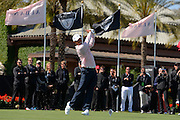 Tiger Woods of the US tees off on the first hole during the 2013 Tavistock Cup at Isleworth Golf and Country Club in Windermere, Florida March 26, 2013. ©2013 Scott A. Miller