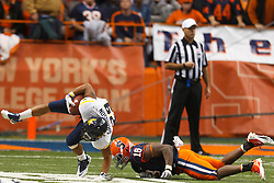 Oct 21, 2011; Syracuse NY, USA;  West Virginia Mountaineers running back Dustin Garrison (29) breaks a tackle from Syracuse Orange linebacker Siriki Diabate (18) during the third quarter at the Carrier Dome.  Syracuse defeated West Virginia 49-23. Mandatory Credit: Jason O. Watson-US PRESSWIRE